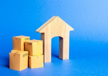 residential-house-and-pile-of-boxes-concept-of-moving-to-another-house-or-city-beginning-of-a-new_t20_jRzQzz